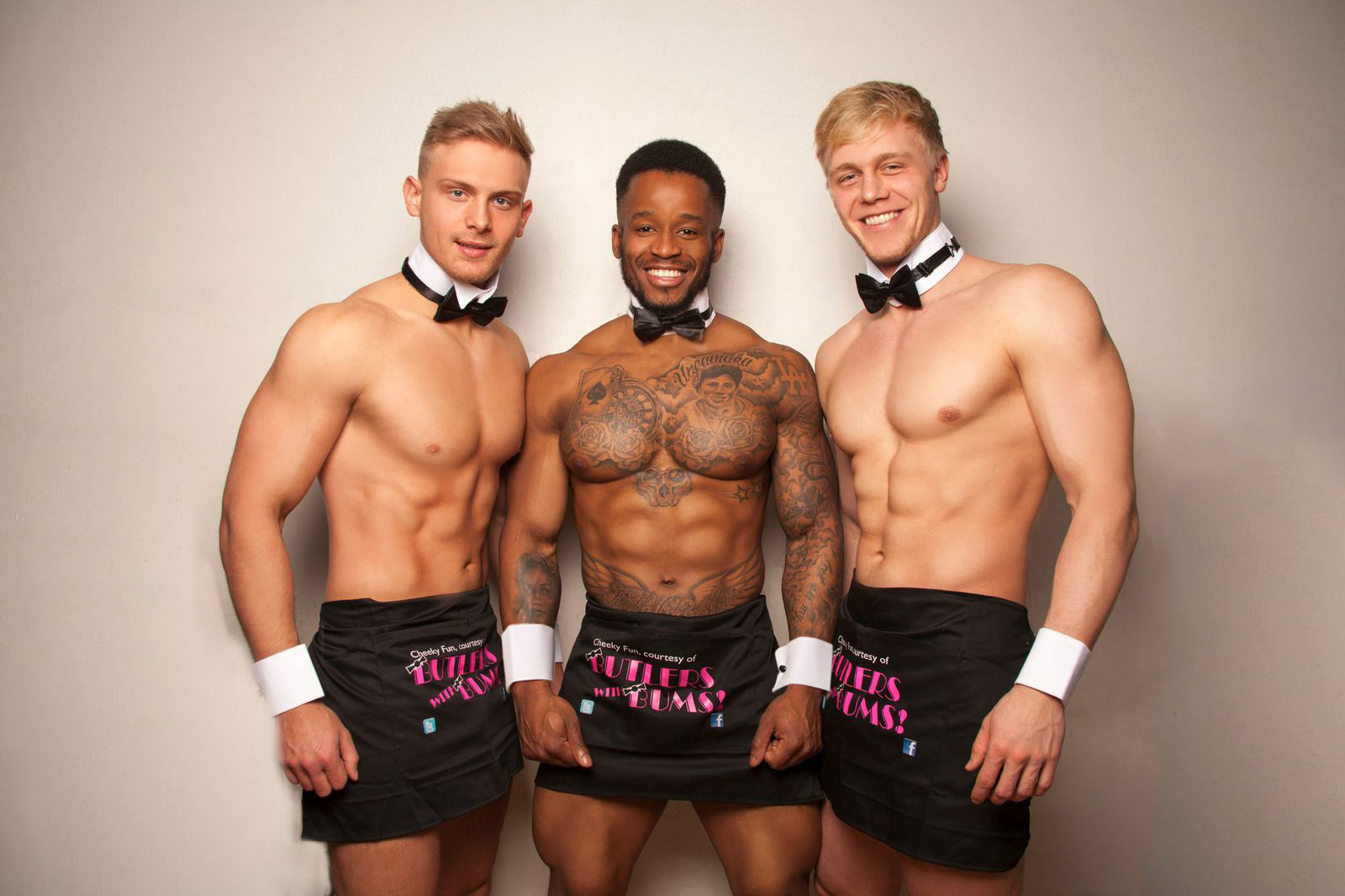 Three butlers stood beside each other for a photo