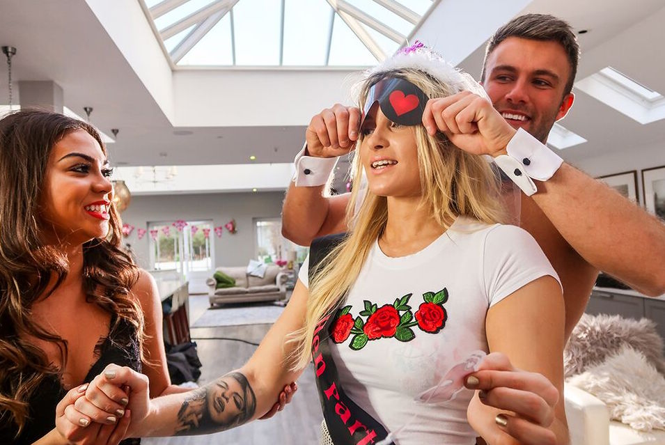 Hen party game of blindfolding bride