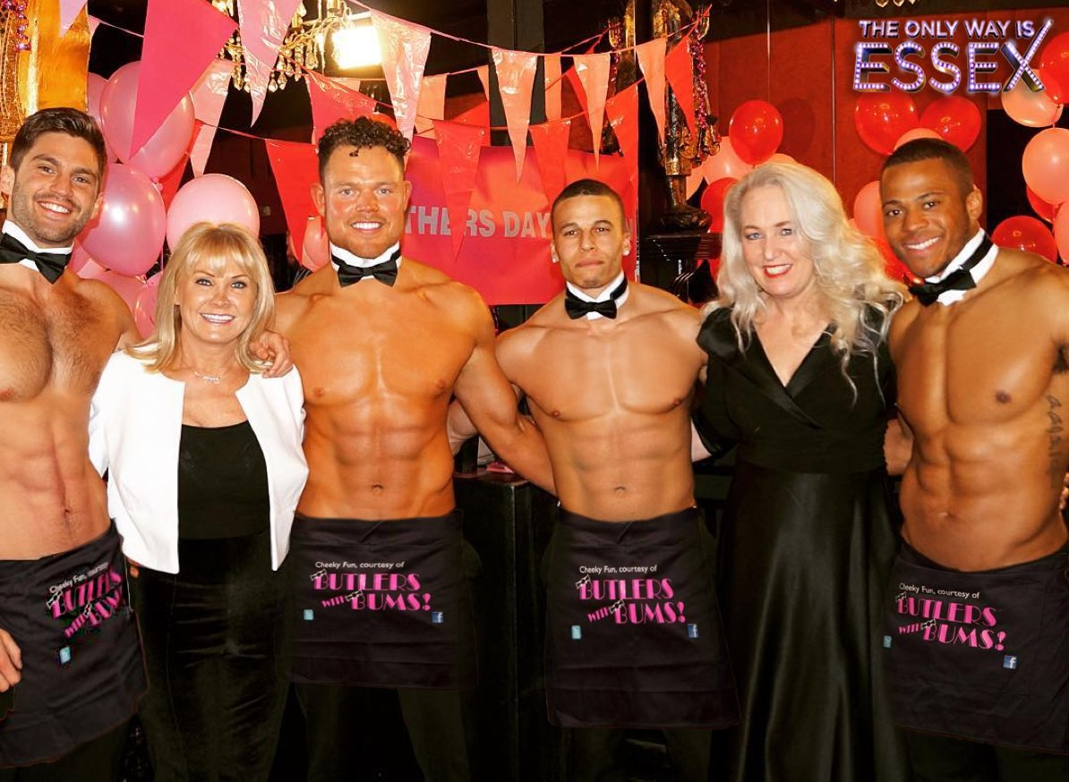 Several butlers stood with a couple of women