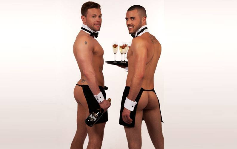 Two butlers showing their bums while posing for photo