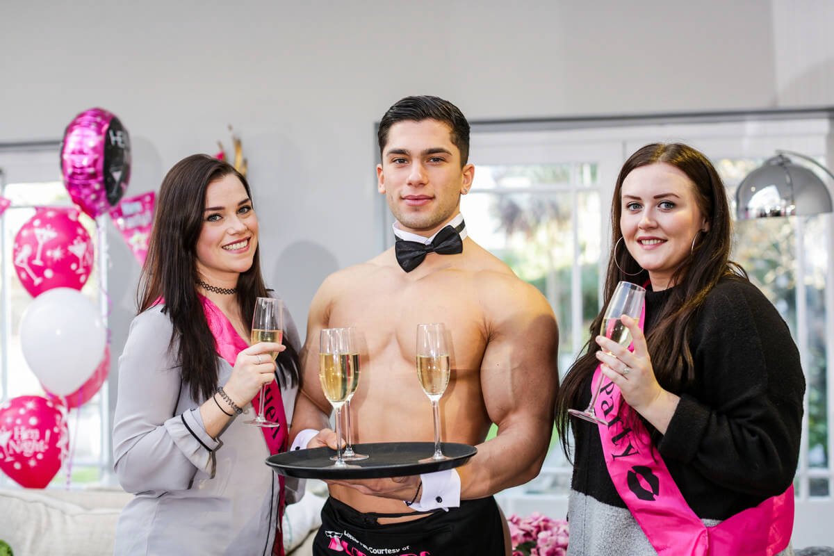 butler with girls and glasses of prosecco