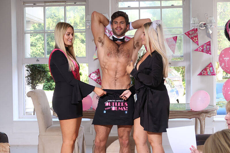 Buff Butler with two hen party guests