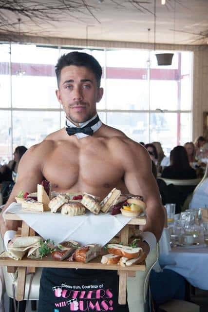 Butler holding a tray of foods