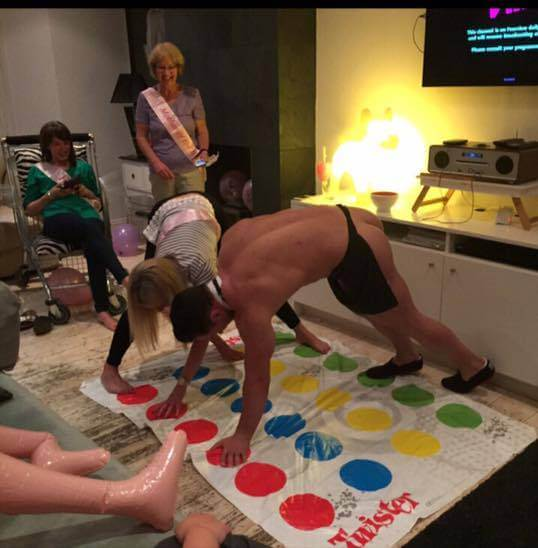 Woman playing twister with a butler
