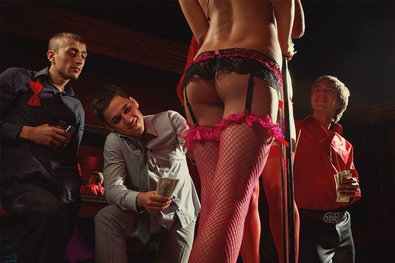 Stripper with three men watching her