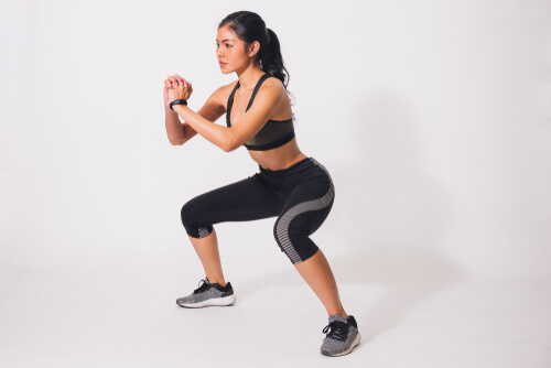 girl squatting for fitness