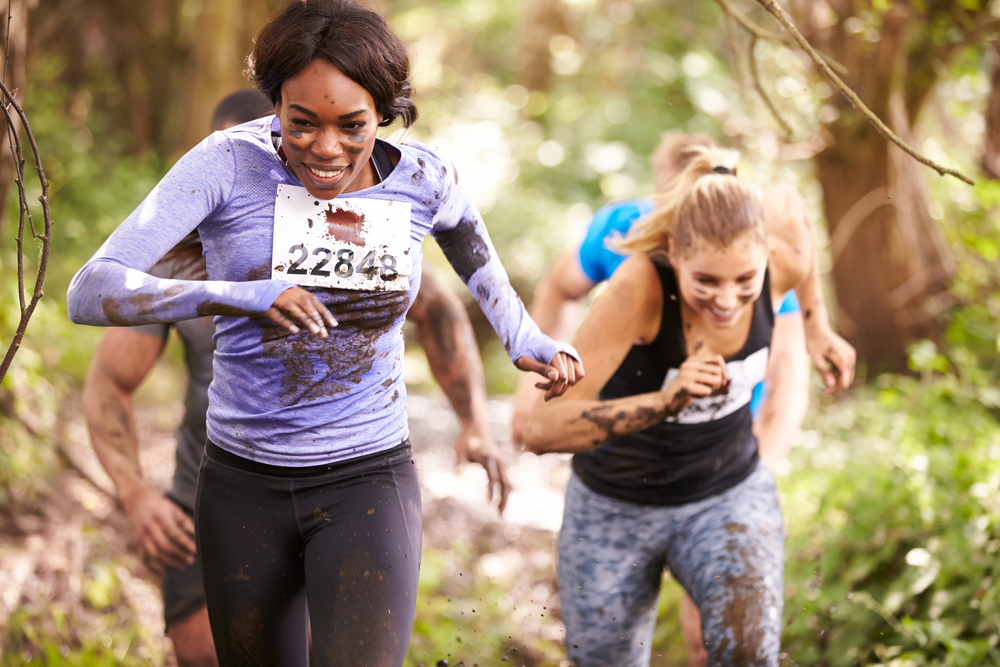 Unique hen party activity where two women run in an assault course